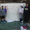 Point Kids Brush An Eyesore Away