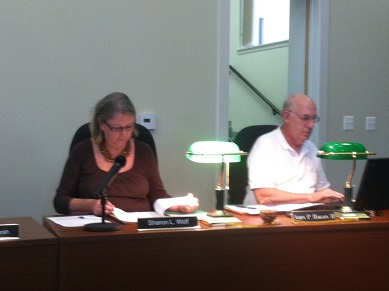 Councilperson Sharon Wolf and Mayor John Hagan prior to the start of Monday evening's council meeting.