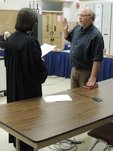 Sam Ganow is sworn in by District Justice Nancy Gill.