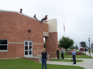 Firefigher cadetsdemonstrate repelling down the building